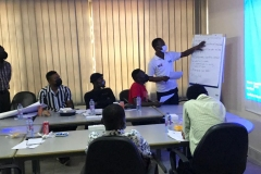 Yusif-presenting-to-the-participants-feedback-from-thier-group-discussions-at-the-HIVST-training